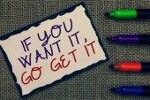 Text sign showing If You Want It, Go Get It.. Conceptual photo Make actions to accomplish your goals wishes Blue bordered page drawn some texts laid color pen jute background