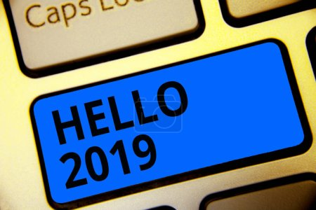 Writing note showing Hello 2019. Business photo showcasing Hoping for a greatness to happen for the coming new year Keyboard blue key Intention computer computing reflection document