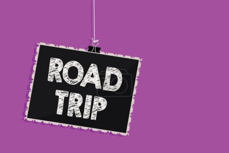 Text sign showing Road Trip. Conceptual photo Roaming around places with no definite or exact target location Hanging blackboard message communication information sign purple background