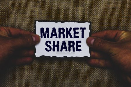 Handwriting text Market Share. Concept meaning The portion of a market controlled by a particular company Man holding piece paper black borders jute background Communicate ideas.