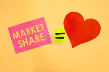 Word writing text Market Share. Business concept for The portion of a market controlled by a particular company Pink piece paper reminder equal sign red heart sending romantic feelings.