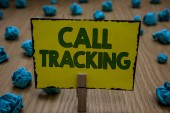 Text sign showing Call Tracking. Conceptual photo Organic search engine Digital advertising Conversion indicator Clothespin holding yellow paper note crumpled papers several tries mistakes.