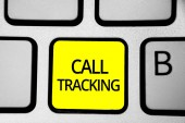 Handwriting text writing Call Tracking. Concept meaning Organic search engine Digital advertising Conversion indicator Keyboard yellow key Intention create computer computing reflection document.