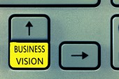Writing note showing Business Vision. Business photo showcasing grow your business in the future based on your goals
