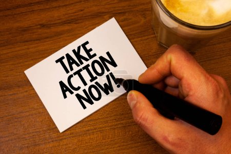 Conceptual hand writing showing Take Action Now Motivational Call. Business photo text Urgent Move Start Promptly Immediate Begin Text white paper hand black marker coffee glass letter.