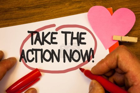 Handwriting text Take The Action Now Motivational Call. Concept meaning Act Start Promptly Immediate Instantly Human hand retain red pen circled black words paper hook rivet pink heart.