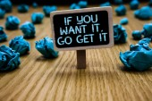 Word writing text If You Want It, Go Get It.. Business concept for Make actions to accomplish your goals wishes Paperclip hold black paperboard with text blue paper lobs on wooden floor.