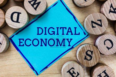 Foto de Texto de escritura de palabras Economía Digital. Concepto empresarial para la red mundial de actividades y tecnologías económicas . - Imagen libre de derechos