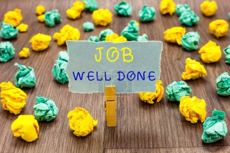 Text sign showing Job Well Done. Conceptual photo Well Performed You did it Cheers Approval Par Accomplished Clothespin holding gray note paper crumpled papers several tries mistakes.