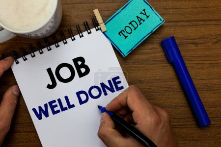 Writing note showing Job Well Done. Business photo showcasing Well Performed You did it Cheers Approval Par Accomplished Man holding marker notebook clothespin reminder wooden table coffee.