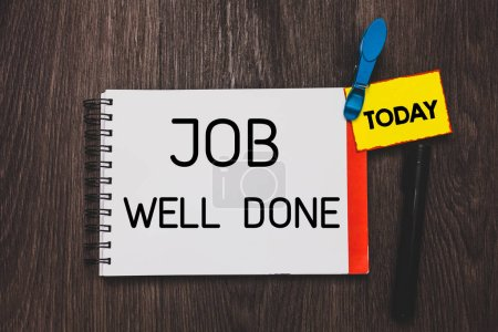 Writing note showing Job Well Done. Business photo showcasing Well Performed You did it Cheers Approval Par Accomplished Open notebook white page clothespin holding reminder wooden background.