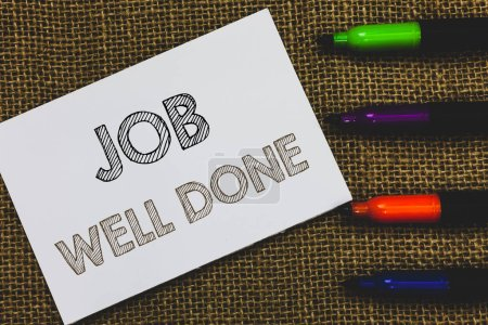 Handwriting text Job Well Done. Concept meaning Well Performed You did it Cheers Approval Par Accomplished White Paper Important reminder Communicate ideas Markers Jute background.