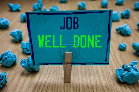 Handwriting text writing Job Well Done. Concept meaning Well Performed You did it Cheers Approval Par Accomplished Clothespin holding blue paper note crumpled papers several tries mistakes.
