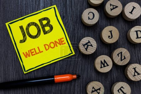 Conceptual hand writing showing Job Well Done. Business photo showcasing Well Performed You did it Cheers Approval Par Accomplished Yellow paper circle Marker express ideas wooden background.