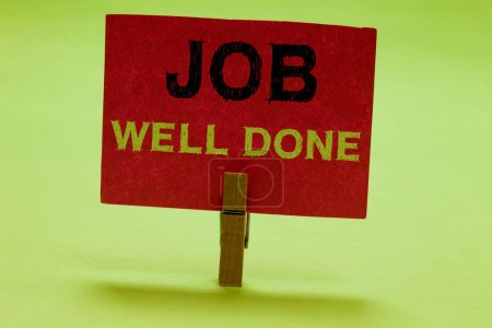 Text sign showing Job Well Done. Conceptual photo Well Performed You did it Cheers Approval Par Accomplished Clothespin holding red paper important communicating messages ideas.