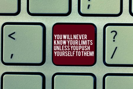 Handwriting text You Will Never Know Your Limits Unless You Push Yourself To Them. Concept meaning Motivation Keyboard key Intention to create computer message, pressing keypad idea.