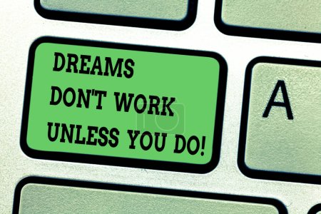Text sign showing Dreams Don T Work Unless You Do. Conceptual photo Take action to accomplish your goals Keyboard key Intention to create computer message pressing keypad idea.