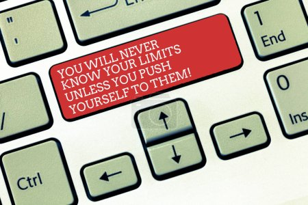 Text sign showing You Will Never Know Your Limits Unless You Push Yourself To Them. Conceptual photo Motivation Keyboard key Intention to create computer message, pressing keypad idea.