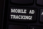 Handwriting text writing Mobile Ad Tracking. Concept meaning monitor brand perforanalysisce including advertising awareness Keyboard key Intention to create computer message pressing keypad idea.