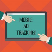 Handwriting text writing Mobile Ad Tracking. Concept meaning monitor brand perforanalysisce including advertising awareness Hu analysis Hands from Both Sides Pointing on a Blank Color Tablet Screen.