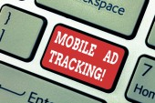 Writing note showing Mobile Ad Tracking. Business photo showcasing monitor brand perforanalysisce including advertising awareness Keyboard key Intention to create computer message pressing keypad idea