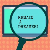 Writing note showing Remain A Dreamer. Business photo showcasing they spend lot of time thinking about and planning things Magnifying Glass Enlarging Tablet Blank Color Screen photo text Space.