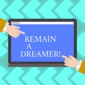 Text sign showing Remain A Dreamer. Conceptual photo they spend lot of time thinking about and planning things Hu analysis Hands from Both Sides Pointing on a Blank Color Tablet Screen.
