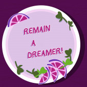 Writing note showing Remain A Dreamer. Business photo showcasing they spend lot of time thinking about and planning things Cutouts of Sliced Lime Wedge and Herb Leaves on Color Plate.