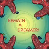 Handwriting text Remain A Dreamer. Concept meaning they spend lot of time thinking about and planning things Starfish photo on Four Corners with Colorful Pebbles for Poster Ads Cards.