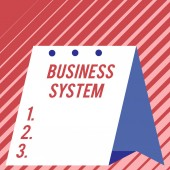 Text sign showing Business System. Conceptual photo A method of analyzing the information of organizations Modern fresh and simple design of calendar using hard folded paper material.