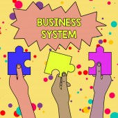 Text sign showing Business System. Conceptual photo A method of analyzing the information of organizations Three Colored Empty Jigsaw Puzzle Pieces Held in Different People Hands.