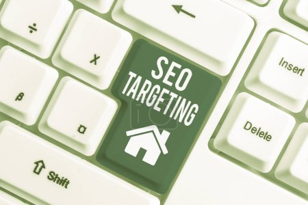 Conceptual hand writing showing Seo Targeting. Business photo showcasing Specific Keywords for Location Landing Page Top Domain White pc keyboard with note paper above the white background.