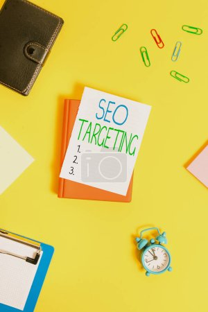 Handwriting text Seo Targeting. Concept meaning Specific Keywords for Location Landing Page Top Domain Paper clips with blank papers for text messages.