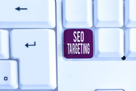 Writing note showing Seo Targeting. Business photo showcasing Specific Keywords for Location Landing Page Top Domain White pc keyboard with note paper above the white background.
