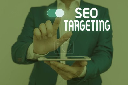 Word writing text Seo Targeting. Business concept for Specific Keywords for Location Landing Page Top Domain Male human wear formal work suit presenting presentation using smart device.