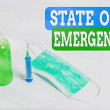 Writing note showing State Of Emergency. Business ...