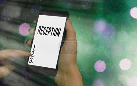 Photo pour Écriture conceptuelle montrant la Réception. Concept signifiant rassemblement social souvent dans le but d'étendre un accueil gadgets modernes écran blanc sous fond bokeh coloré - image libre de droit