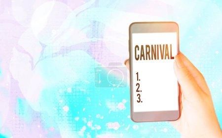 Photo pour Texte d'écriture de mots Carnaval. Photo d'affaires présentant une entreprise itinérante offrant des divertissements, des expositions, etc. gadgets modernes avec écran d'affichage blanc sous fond bokeh coloré - image libre de droit