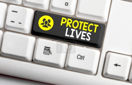 Photo for Writing note showing Protect Lives. Business concept for to cover or shield from exposure injury damage or destruction Colored keyboard key with accessories arranged on empty copy space - Royalty Free Image