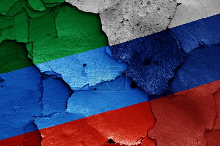 flags of Dagestan and Russia painted on cracked wall