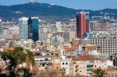 Barcelona, Spain - January 21, 2019: View of Barcelona downtown from hill Montjuic in sunny day