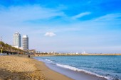 Barcelona, Spain - January 19, 2019: View of Barceloneta beach. It is oldest and most famous in city, located in neighborhood of La Barceloneta (Ciutat Vella)