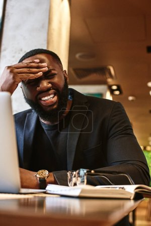 Photo for Frustrated stressed businessman feeling tired of computer work sitting at workplace, exhausted man in suit suffers from eye strain or blurry vision problem after long laptop use, eyes fatigue concept - Royalty Free Image