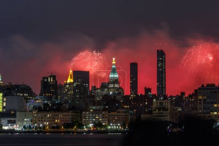 Photo for Celebrations July 4th in New York, Manhattan skyline from Hudson river and fireworks. - Royalty Free Image