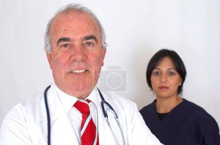 Happy doctors team on white background...
