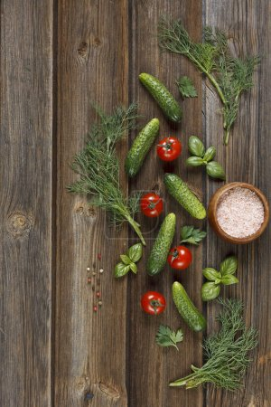 close-up photo of fresh raw vegetables on wooden table background with salt