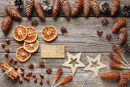Photo for Christmas  background  with cones, dry orange slices, anise stars and cinnamon sticks on wooden table, top view - Royalty Free Image