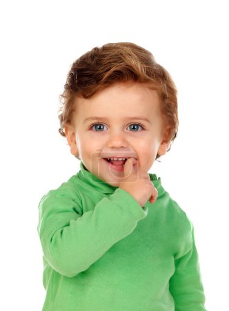 adorable smiling little boy in green jersey isolated over white background