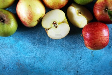Photo for Ripe red apples with leaves on wooden background - Royalty Free Image