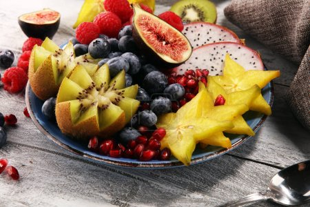 Photo for Fruit bowl. Bowl of healthy fresh fruit salad on rustic background - Royalty Free Image